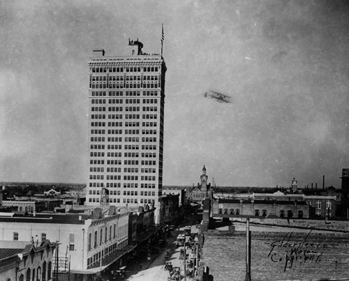 Biplane Circles Amicable Building in Famous Flight